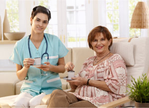 nurse and senior patient drinking coffee