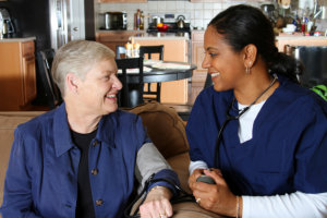 home health care worker and an elderly woman